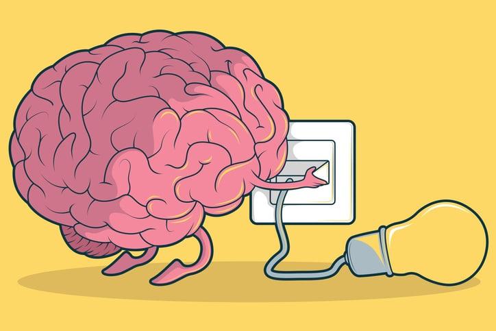 Brain plugging in a light blub.
